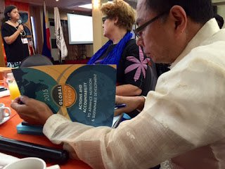 Health Undersecretary of State Gako reading the GNR 2015 Report
